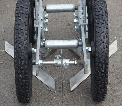 Closeup photo of the front of the Four Wheel Hoe ...